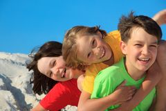 Siblings playing on beach stock photography