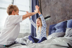 Siblings playing on bed Royalty Free Stock Photography