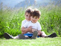 Siblings playing in field Stock Photo