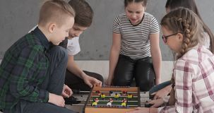 Siblings playing foosball at home. Brothers and sisters playing foosball together at home stock video footage