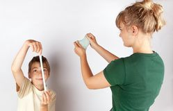 Siblings playing with slime toy royalty free stock photos