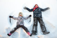 Siblings playing in a snow enjoying winter Royalty Free Stock Photos