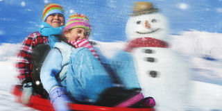 Siblings Playing Snow Sledge In The Snow Concept Royalty Free Stock Image