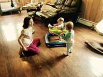 Siblings Playing Together in Livingroom royalty free stock photo
