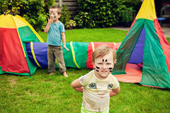 Siblings playing with toy tent Royalty Free Stock Photography