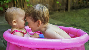 Siblings playing in a tub Royalty Free Stock Photo