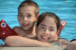 Siblings at the pool Stock Photos