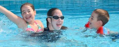Siblings in the pool Royalty Free Stock Image