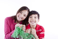 Siblings popping bubble wrap. Stock Images