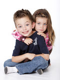 Siblings portrait. Isolated on a white background Royalty Free Stock Image