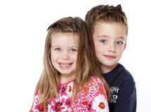 Siblings portrait. Isolated on a white background Royalty Free Stock Photos