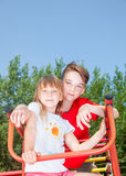 Siblings posing on a jungle gym Royalty Free Stock Images