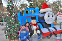 Siblings posing with thomas the train. The picture is taken at Thomas land in Fuji-Q Highlands theme park , Japan where a replica of the famous thomas the train Stock Photography
