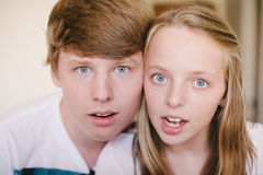 Siblings posing together making a shocked face. Royalty Free Stock Images
