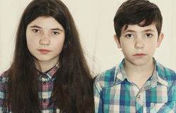 Siblings preteen boy and teenager girl Stock Images