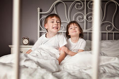 Siblings pulling faces Stock Photography