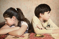Siblings after quarreling Royalty Free Stock Image