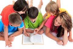 Siblings Reading Book Royalty Free Stock Image