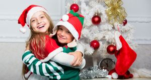 Siblings ready celebrate christmas or meet new year. Merry christmas. Family holiday tradition. Children cheerful. Celebrate christmas. Kids christmas costumes stock photo
