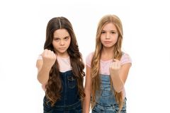 Siblings relations. Sisterhood goals. Sisters little kids isolated white background. Sisterly relationship. Sisterhood. Happiness and issues. Girls confident stock image