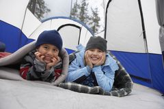 Siblings Relaxing Inside Tent Royalty Free Stock Photo