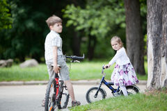 Siblings riding bicycles Stock Photography