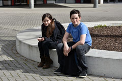 Siblings at the schoolyard Stock Photography