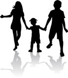 Siblings - silhouettes Stock Photos