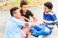 Siblings sitting on floor in yard Royalty Free Stock Photo