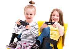 Siblings playing battles with joystick Stock Photography