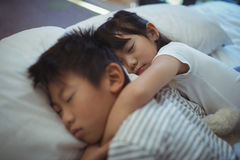 Siblings sleeping on bed in the bed room Royalty Free Stock Photo