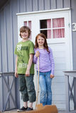 Siblings Standing Together At Entrance Of Camping Houses Stock Photos