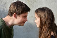 Face to face, siblings staring at each other. Siblings staring at each other. Its a game whoever looks away  first, lost Royalty Free Stock Image