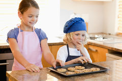 Siblings stealing cookies Royalty Free Stock Photo