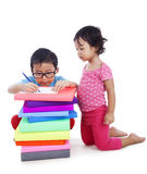 Siblings studying isolated over white Stock Image