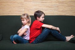 Siblings sulking after fight Royalty Free Stock Photos