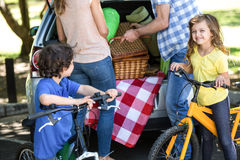 Siblings with their bikes Royalty Free Stock Photography