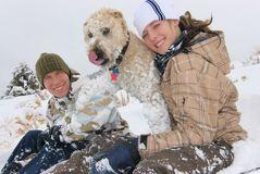 Siblings and their dog Royalty Free Stock Photo