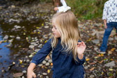 Siblings Throwing Rocks In River Together Royalty Free Stock Photos