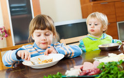 Siblings together eating food Royalty Free Stock Images