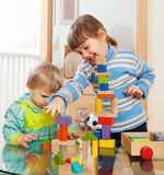 Siblings together playing with  toys Royalty Free Stock Photos
