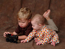 Siblings with Toy Train Royalty Free Stock Photography