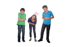 Siblings with tummy ache. Three young siblings holding their sore tummies stock photography