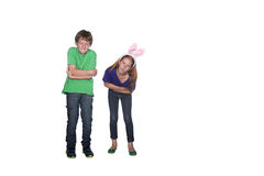 Siblings with tummy ache Royalty Free Stock Photos