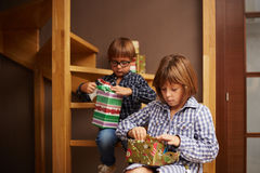 Siblings unwrapping Christmas presents Royalty Free Stock Photo
