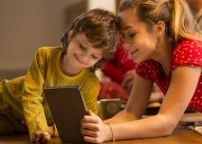 Siblings Using Digital Tablet royalty free stock image