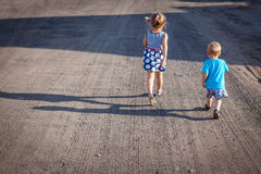Siblings on a walk Stock Photography