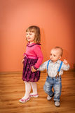 Siblings walking together Royalty Free Stock Images