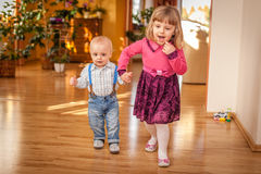 Siblings walking together Royalty Free Stock Image