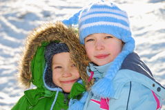 Siblings in winter clothes  Royalty Free Stock Photography